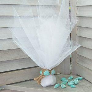 Μπομπονιέρες γάμου με θέμα θάλασσα: τούλινη μπομπονιέρα με κοχύλια