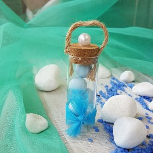 Μπομπονιέρες γάμου με θέμα θάλασσα: δοκιμαστικός σωλήνας με σπαγκο και λευκή πέρλα