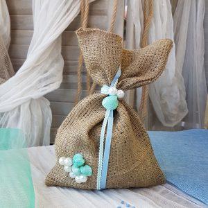 Μπομπονιέρες γάμου με θέμα θάλασσα: πουγκί λινάτσα με πέρλες
