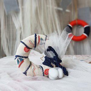 παιδικες μπομπονιέρες σωσίβιο απο φελιζόλ τυλιγμένο με λονέτα με ναυτικό τύπωμα
