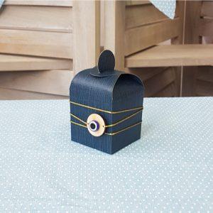 μπομπονιέρα σκούρο μπλε κουτί με μάτι