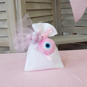 λευκό πουγκί για μπομπονιέρα διακοσμημένη με ροζ υφασμάτινο μάτι