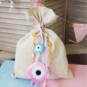 υφασμάτινο πουγκί με ροζ κορδέλες και ροζ μάτι για αποθήκευση λαδικών