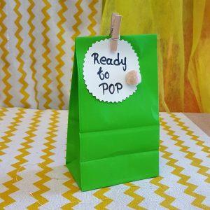 Πράσινη χάρτινη σακουλίτσα με ζαχαρωτά